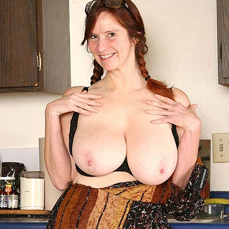 Redhead Breeze shows her tits in the kitchen