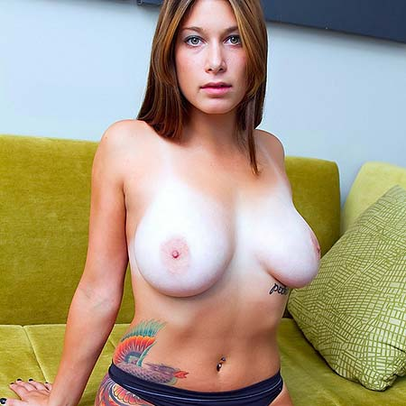 Janine has great tanlines on her big tits