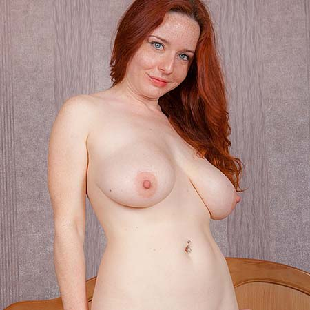 Redhead Sara Nikol gets ready to toy herself