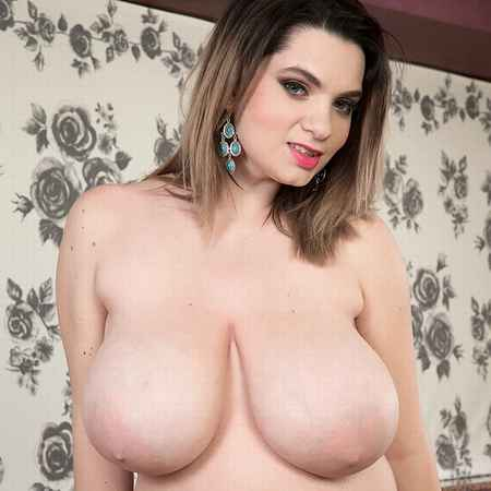 Busty newcomer Kitty Cute shows her juicy big tits at Scoreland