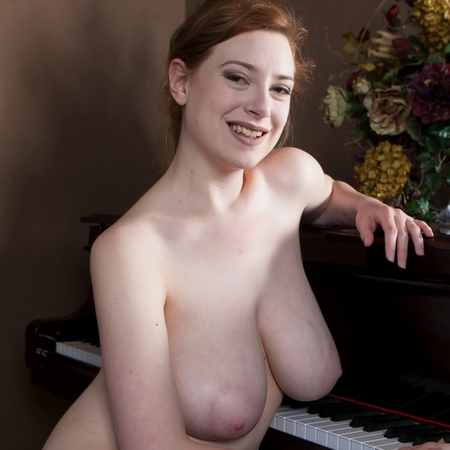 Sophisticated busty beauty Misha naked with a piano - Cosmid