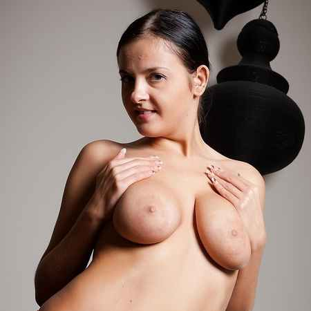 Candy loves to show her big tits and pussy