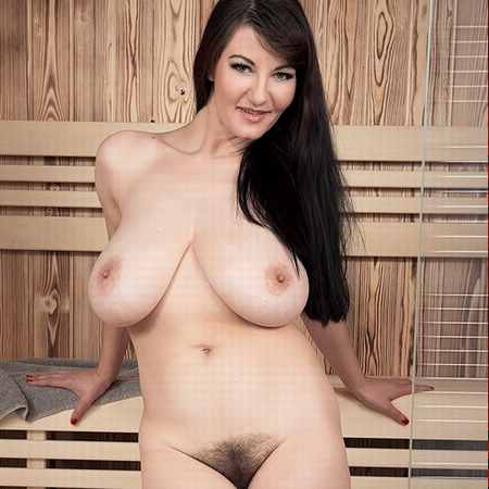 Hairy and busty Vanessa in the sauna of Scoreland